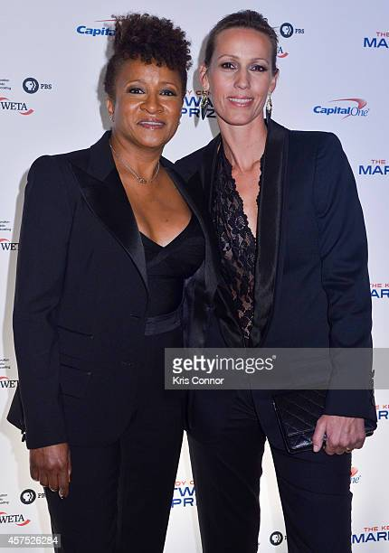 Wanda Sykes and Alex Sykes walk the red carpet during the 2014 Kennedy Center's Mark Twain Prize For Americacn Humor at The John F Kennedy Center for...