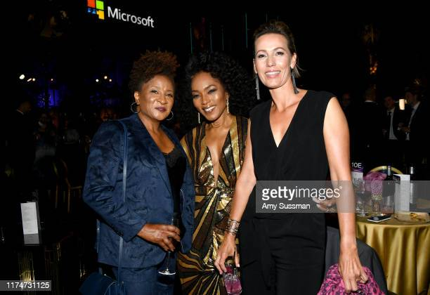 Wanda Sykes, Angela Bassett and Alex Sykes attend the Governors Ball during the 2019 Creative Arts Emmy Awards on September 14, 2019 in Los Angeles,...