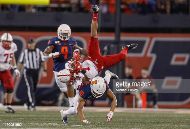 Wan'Dale Robinson of the Nebraska Cornhuskers is upended by Sydney Brown of the Illinois Fighting Illini during the first half at Memorial Stadium on...
