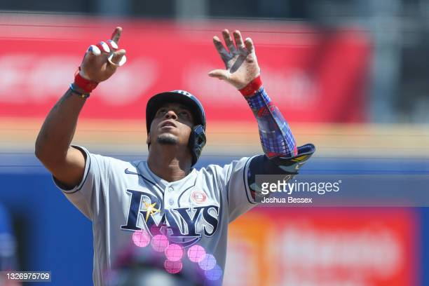 Wander Franco of the Tampa Bay Rays celebrates his home run during the sixth inning against the Toronto Blue Jays at Sahlen Field on July 04, 2021 in...