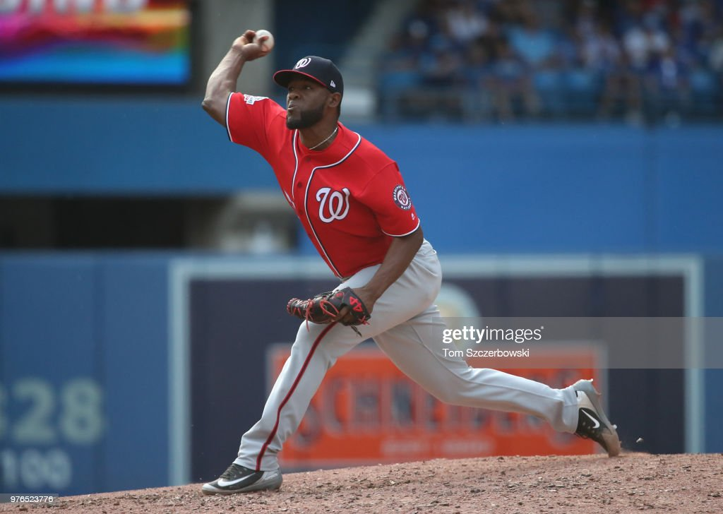 Wander Suero #51 of the Washington Nationals delivers a pitch in the seventh inning during MLB game action against the Toronto Blue Jays at Rogers Centre on June 16, 2018 in Toronto, Canada.
