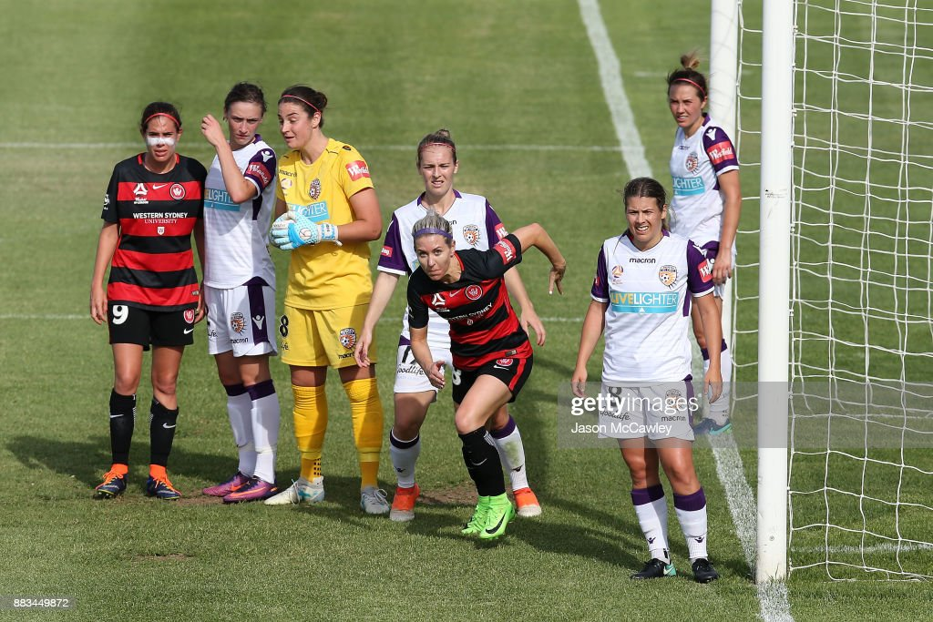 Wanderers and Glory players compete for the ball during the round six W-League match between the Western Sydney Wanderers and the Perth Glory at Marconi Stadium on December 1, 2017 in Sydney, Australia.