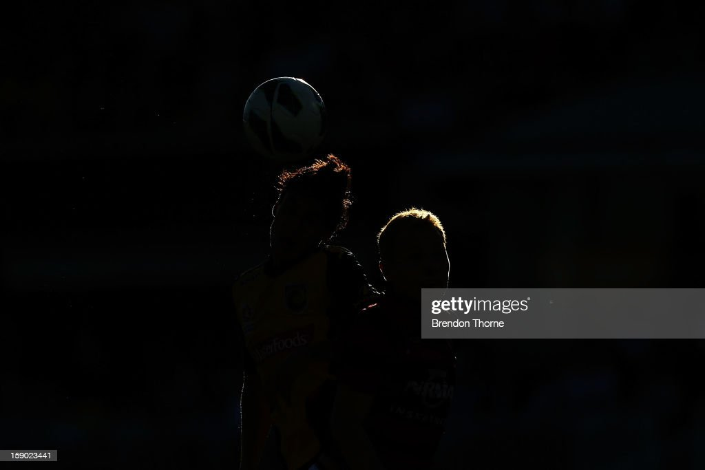 A Wanderers and Mariners player heads the ball during the round 15 A-League match between the Western Sydney Wanderers and the Central Coast Mariners at Parramatta Stadium on January 6, 2013 in Sydney, Australia.