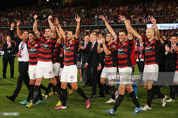 Wanderers captain Michael Beauchamp hold the Premiers' Plate aloft and celebrates with team mates after winning the ALeague Semi Final match between...