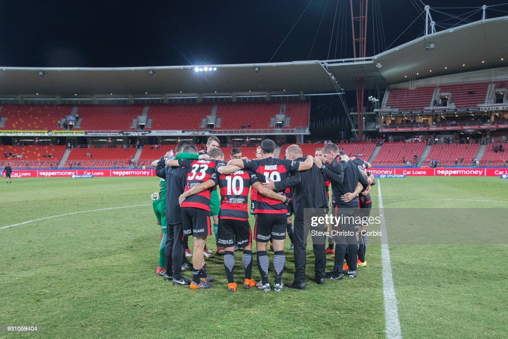 Wanderers celebrate their 4-1 win over the Phoenix with a team huddle after the round 22 A-League match between the Western Sydney Wanderers and the Wellington Phoenix at Spotless Stadium on March 10, 2018 in Sydney, Australia.