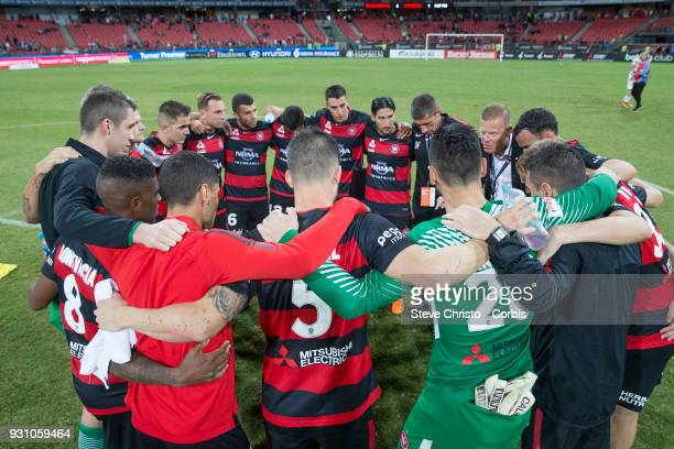 Wanderers celebrate their 41 win over the Phoenix with a team huddle after the round 22 ALeague match between the Western Sydney Wanderers and the...