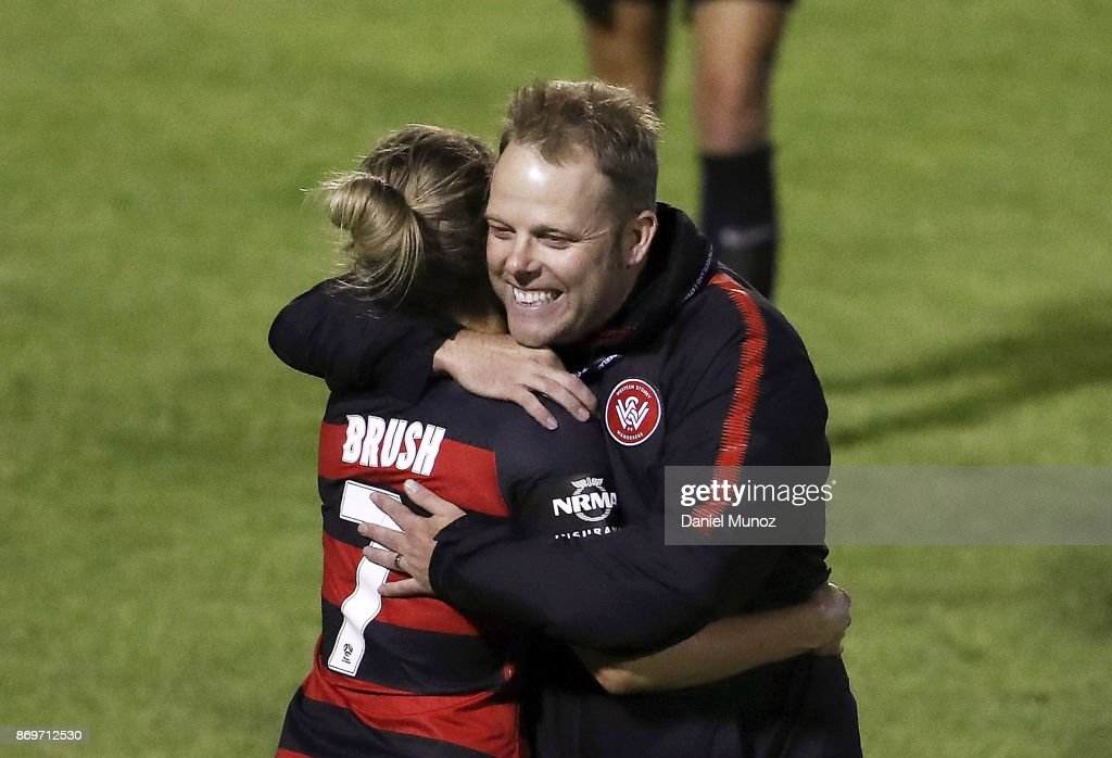 Wanderers coach Richard Byrne embraces Ellie Brush after winning the round two W-League match between the Western Wanderers and Adelaide United at Marconi Stadium on November 3, 2017 in Sydney, Australia.