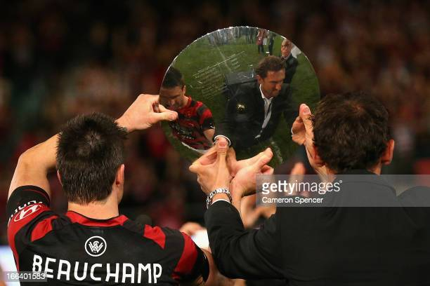 Wanderers coach Tony Popovic and captain Michael Beauchamp hold the Premiers' Plate aloft after winning the ALeague Semi Final match between the...