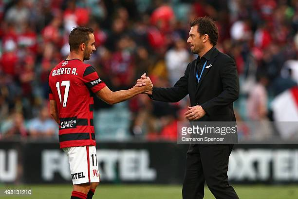 Wanderers coach Tony Popovic congratulates Alberto Aguilar of the Wanderers after winning the round seven ALeague match between Western Sydney...