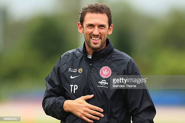 Wanderers coach Tony Popovic shares a joke with his players during a Western Sydney Wanderers ALeague training session at Blacktown International...