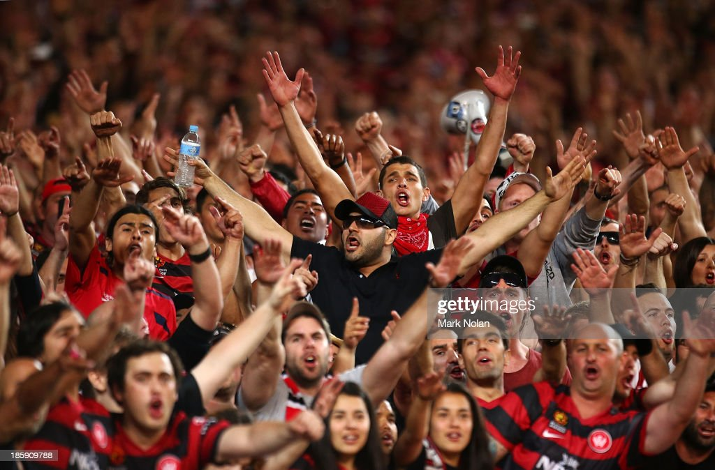 Wanderers fans celebrate during the round three A-League match between Sydney FC and the Western Sydney Wanderers at Allianz Stadium on October 26, 2013 in Sydney, Australia.