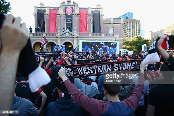 Wanderers fans celebrate victory after watching the Asian Champions League final match between Western Sydney Wanders and Al Hilal at Centenary...