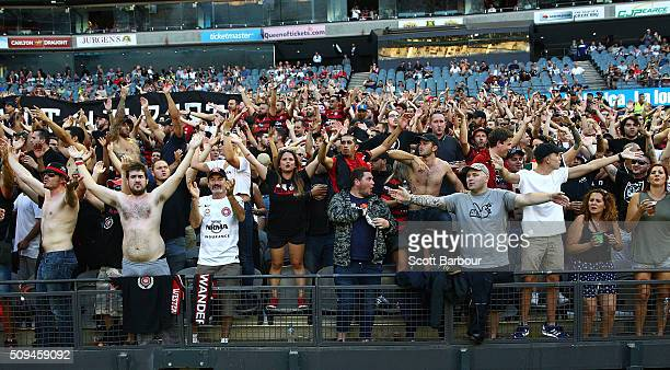Wanderers fans in the crowd let off flares as police officers look on during the round 18 A-League match between the Melbourne Victory and Western...