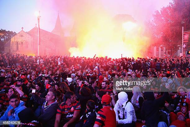 Wanderers fans light flares as they watch the Asian Champions League final match between Western Sydney Wanders and Al Hilal at Centenary Square in...