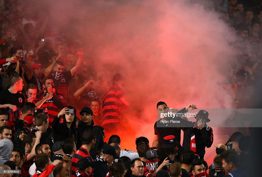 Wanderers fans look on as a flare is lit during the round one A-League match between the Western Sydney Wanderers and Sydney FC at ANZ Stadium on October 8, 2016 in Sydney, Australia.