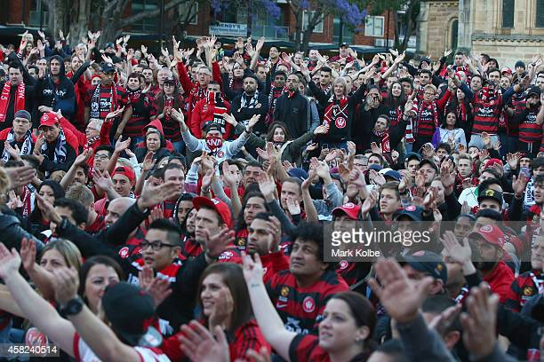 Wanderers fans sing as they watch the Asian Champions League final match between Western Sydney Wanders and Al Hilal at a live site in Centenary...