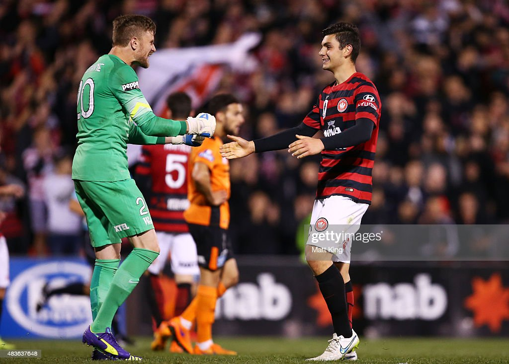 Wanderers goalkeeper Andrew Redmayne (L) celebrates with Daniel Alessi (R) after victory in the FFA Cup match between Western Sydney Wanderers and Brisbane Roar at Pepper Stadium on August 11, 2015 in Sydney, Australia.