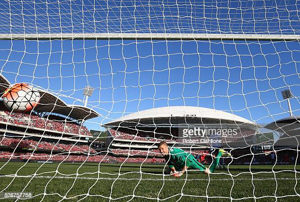 Wanderers goalkeeper Andrew Redmayne is beaten by a shot from Bruce Kamau of Adelaide United during the 2015/16 ALeague Grand Final match between...