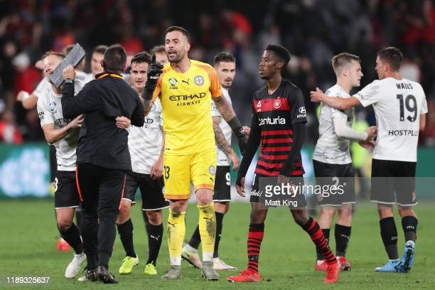 Wanderers goalkeeping coach Davide Del Giovine is held back by Scott Jamieson of Melbourne City FC after having words with Melbourne City FC...