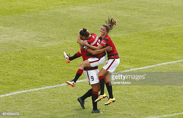 Wanderers Katherine Stengel celebrates with Eliza Ammendolia and Rachel Lowe after scoring during the round three WLeague match between the Western...