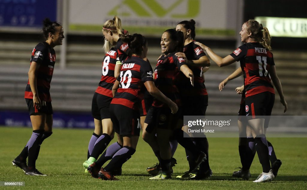 Wanderers Lo'eau Labonta (centre) celebrates with teammates after scoring during the round two W-League match between the Western Wanderers and Adelaide United at Marconi Stadium on November 3, 2017 in Sydney, Australia.