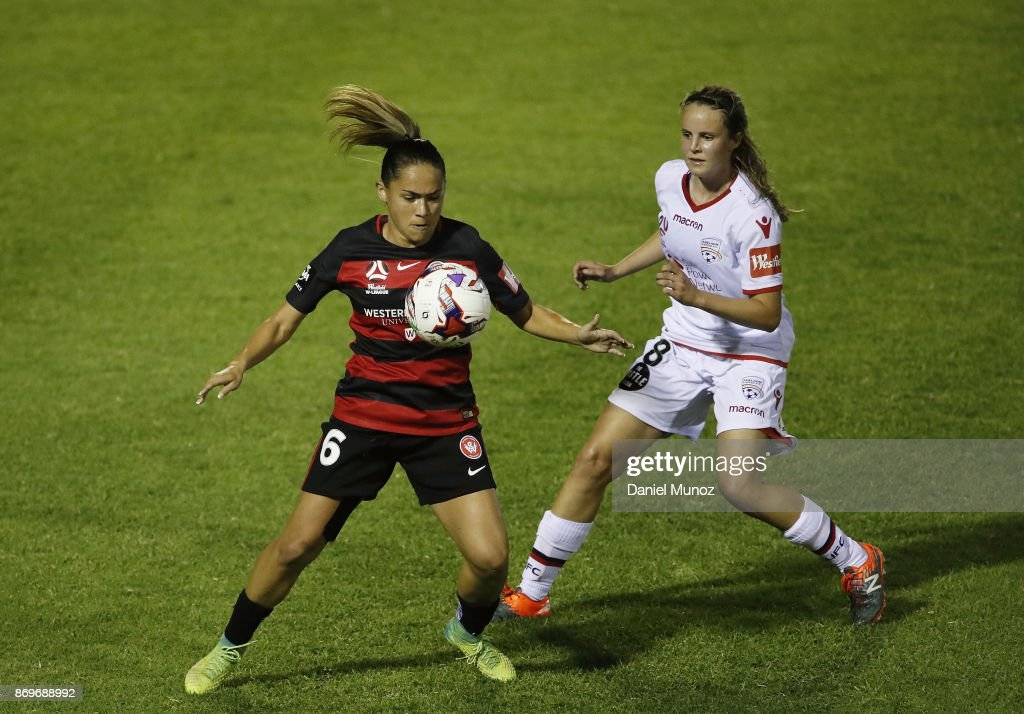 Wanderers Lo'eau Labonta fights for the ball against Emily Condon of Adelaide United during the round two W-League match between the Western Wanderers and Adelaide United at Marconi Stadium on November 3, 2017 in Sydney, Australia.