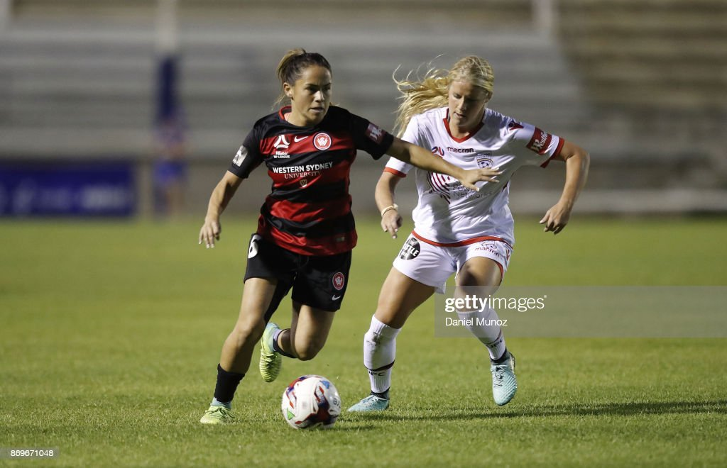 Wanderers Lo'eau Labonta fights for the ball against Makenzy Doniak of Adelaide United during the round two W-League match between the Western Wanderers and Adelaide United at Marconi Stadium on November 3, 2017 in Sydney, Australia.