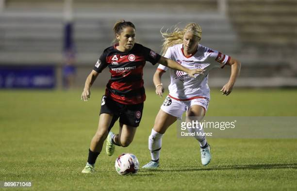 Wanderers Lo'eau Labonta fights for the ball against Makenzy Doniak of Adelaide United during the round two WLeague match between the Western...
