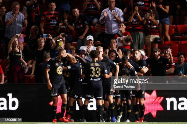 Wanderers players celebrate a goal during the round 19 ALeague match between Adelaide United and the Western Sydney Wanderers at Coopers Stadium on...