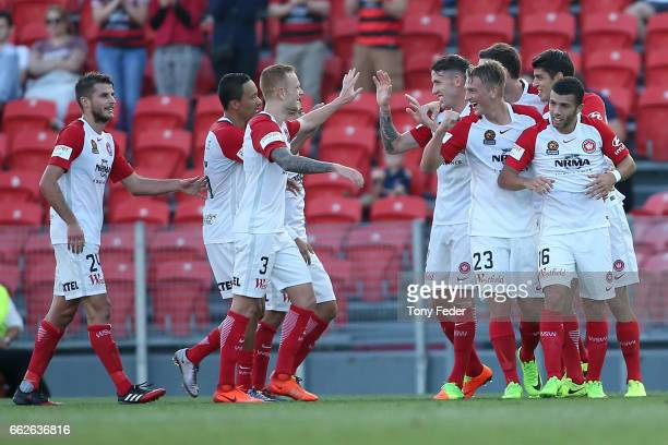 Wanderers players celebrate a goal during the round 25 ALeague match between the Newcastle Jets and the Western Sydney Wanderers at McDonald Jones...