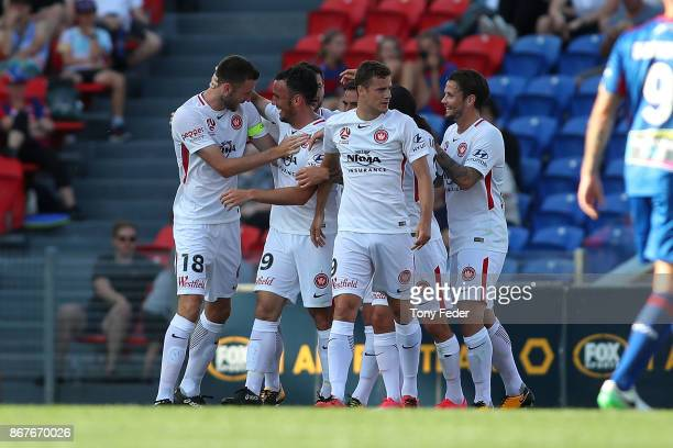 Wanderers players celebrate a goal during the round four ALeague match between the Newcastle Jets and the Western Sydney Wanderers at McDonald Jones...