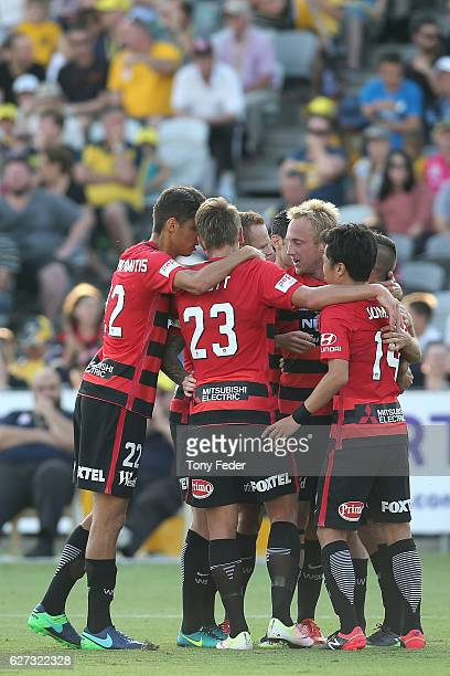Wanderers players celebrate a goal during the round nine A-League match between Central Coast Mariners and the Western Sydney Wanderers at Central...