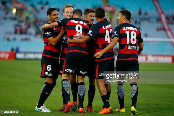 Wanderers players celebrate after Oriol Riera scored a goal from the penalty spot during the round 27 ALeague match between the Western Sydney...