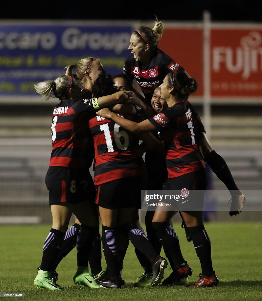 Wanderers players celebrate after scoring during the round two W-League match between the Western Wanderers and Adelaide United at Marconi Stadium on November 3, 2017 in Sydney, Australia.