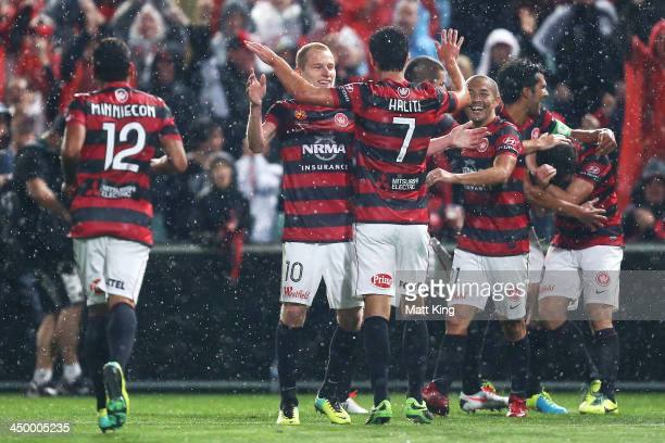 Wanderers players celebrate the goal to Mark Bridge during the round six ALeague match between the Western Sydney Wanderers and the Melbourne Victory...