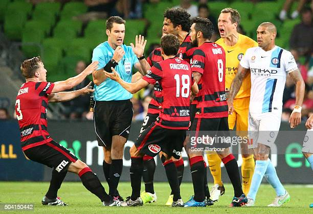 Wanderers players confront referee Jarred Gillett after he ruled that they took their freekick too quickly to score their third goal during the round...