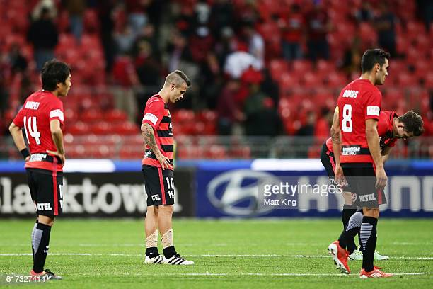Wanderers players look dejected after the round three ALeague match between the Western Sydney Wanderers and the Newcastle Jets at Spotless Stadium...