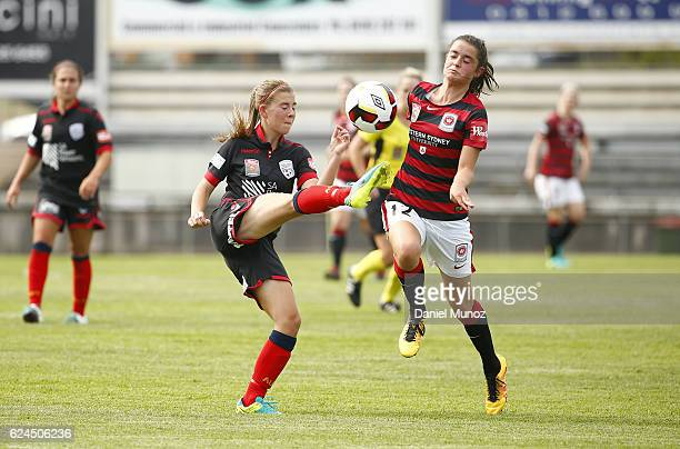 Wanderers Rachel Lowe fights for the ball against Adelaide Emily Hodgson during the round three WLeague match between the Western Sydney Wanderers...