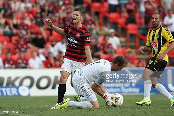 Wanderers Shannon Cole was late to this cross as Glen Moss of the Wellington Phoenix cuts it off at Penrith Stadium Australia Sydney Australia Sunday...