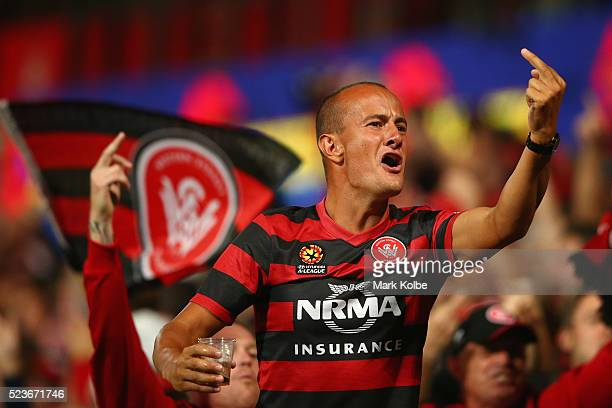 Wanderers supporter gestures to Roar supporters as he cheers a goal during the ALeague Semi Final match between the Western Sydney Wanderers and the...