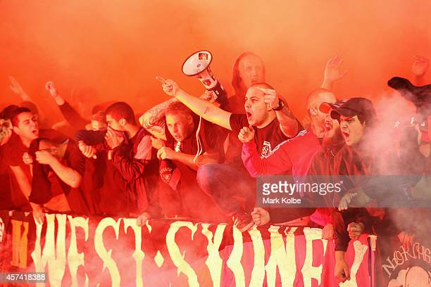 Wanderers supporters set off a smoke flare as they sing before kick-off during the round two A-League match between Sydney FC and the Western Sydney...