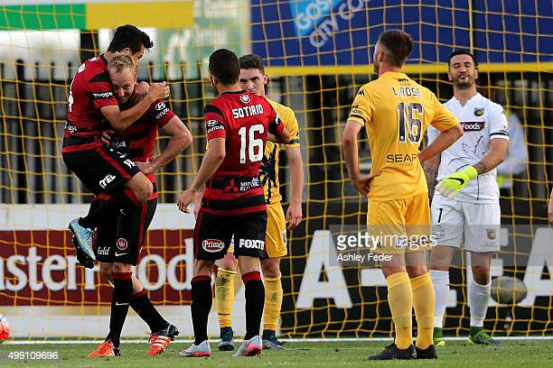 Wanderers team mates celebrate a goal by Mitch Nichols during the round eight ALeague match between the Central Coast Mariners and the Western Sydney...