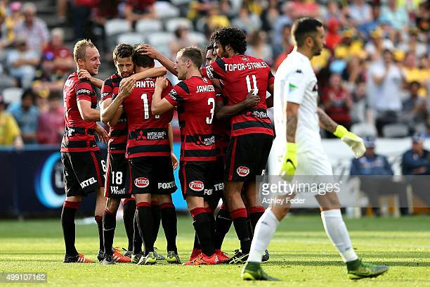 Wanderers team mates celebrate a goal during the round eight ALeague match between the Central Coast Mariners and the Western Sydney Wanderers at...