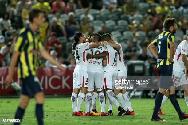 Wanderers team mates celerbate a goal from Alvaro Cejudo of the Wanderers with Mariners players looking dejected in frame during the round 11 ALeague...
