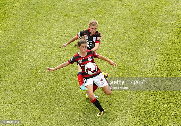 Wanderes Rachel Lowe contests the ball against Adelaide Emili Hodgson during the round three WLeague match between the Western Sydney Wanderers and...