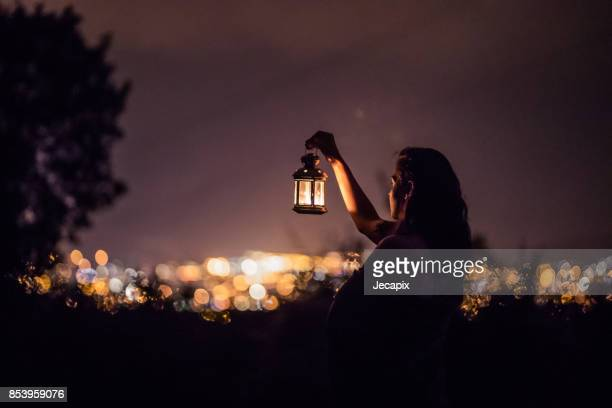 wandering through the night - lantern stock photos and pictures