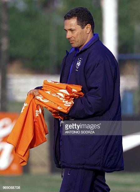 Wanderley Luxemburgo Brazilian coach of the soccer selectrion passes vests to the players during the practice 24 July 2000 in Sao Paulo Brazil...