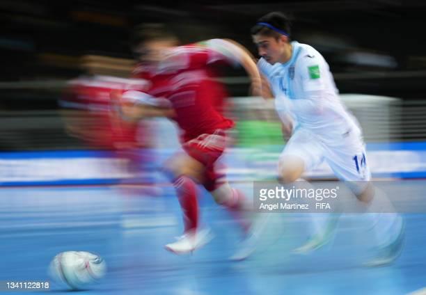 Wanderley Ruiz of Guatemala and Ivan Milovanov of RFU challenge for the ball during the FIFA Futsal World Cup 2021 group B match between Guatemala...