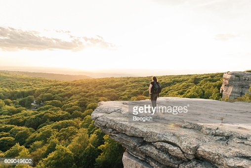 wanderlust adventure hiking woman enjoys sunset catskills