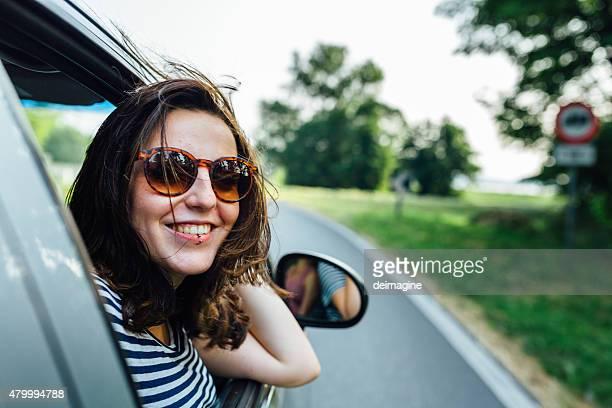 Wanderlust woman traveling by car
